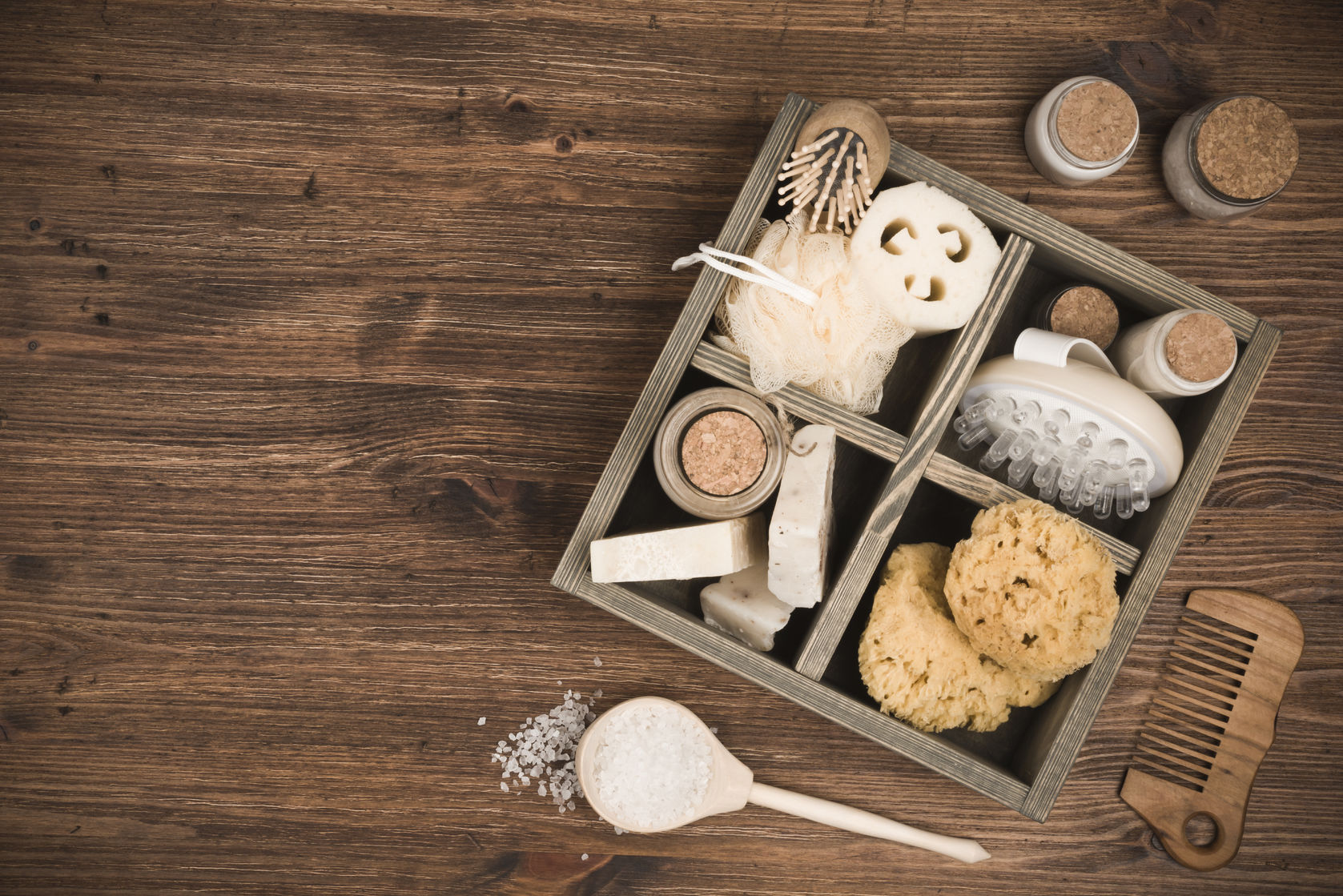 spa threatment and massage products in box on wooden background