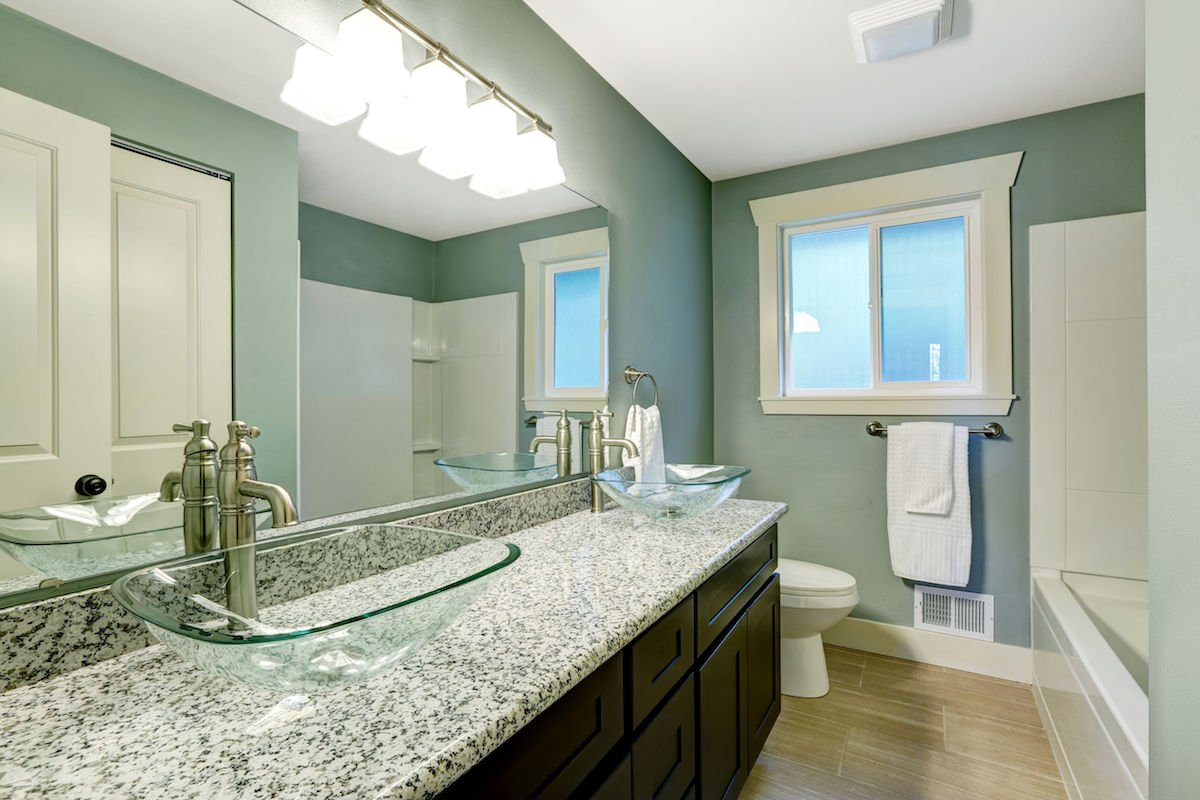 Modern bathroom interior in soft aqua color - vessel sink maintenance